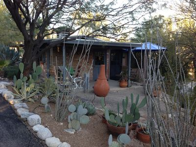Outside front porch area with lots of desert vegetation