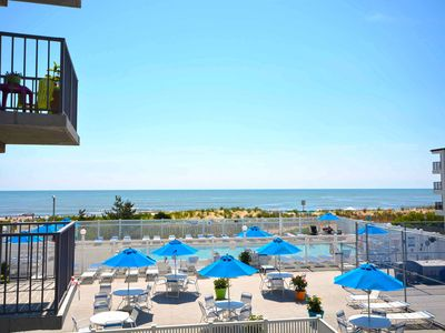 Photo for Warm, cozy 2-bedroom oceanfront condo with a gorgeous ocean view, free WiFi, an outdoor pool, and a game room located midtown!