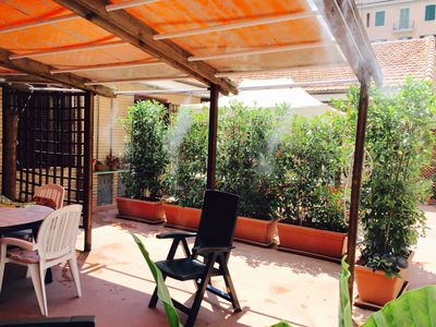 Patio with   misters to help you keep cool