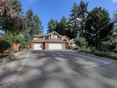 Photo for Spacious house w/basketball court surrounded by trees & great location!