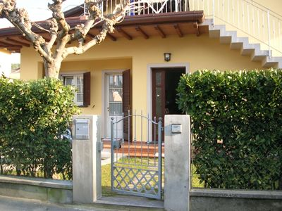 Photo for Ground floor of attractive semi-detached villa in quiet, residential area, 900m from the beach. Priv