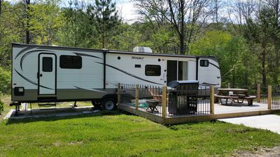 "38"" long travel trailer, deck with picnic table, grill, private wooded setting"