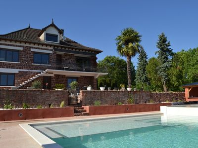 Photo for large capacity cottage with heated infinity pool and Jacuzzi