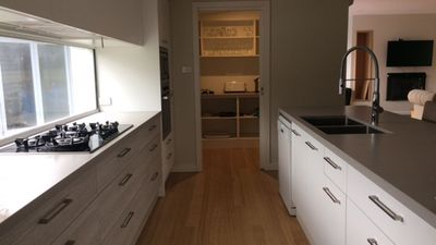 Amazing kitchen, stone bench tops, walk in pantry.