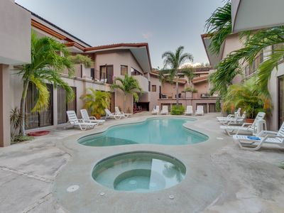 Photo for Spacious condo with shared pools, tennis, and more - walk to the beach!