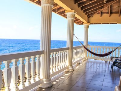 Photo for Ocean front- private home - pool and guest house, near West Bay - Sea Views!!