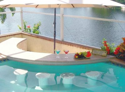 The all time favorite Swim-up Pool Bar with in-water stools