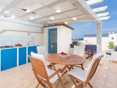 Photo for Apartment by the beach of San Vito Lo Capo, large terrace and stunning sea-views