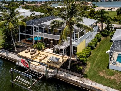 Photo for Key West Style Waterfront Home! Screened in Waterfall Pool, Amazing Lanai, Wrap-Around Balcony, WiFi