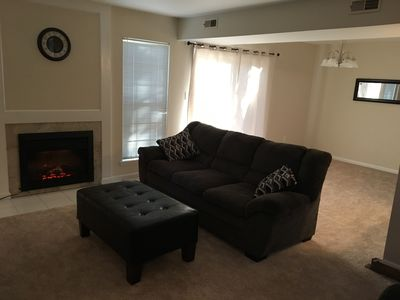 Family room with Fireplace, seating for 5 and Wall Mounted Smart TV