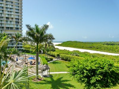 Photo for Cozy beachfront condo w/ heated pool a few steps from Tigertail Beach