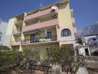 Photo for Two bedroom apartment with balcony and sea view Makarska (A-16161-c)