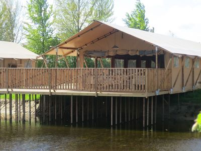 Photo for Combined tents with kitchen and bathroom located near a pond