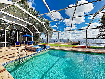 Photo for Tropical Retreat! Riverfront Paradise w/ Caged Pool, Hot Tub & Private Dock