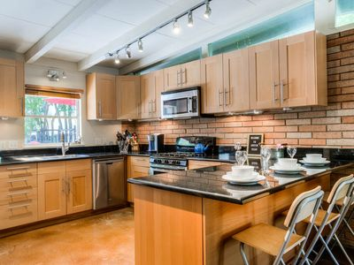 Photo for Walk to UT Football Games! Free parking! Pet Friendly Mid-Century Home