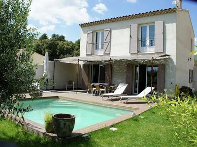 Photo for Provencal villa with pool and views of village and vineyards between Luberon and Aix en Provence