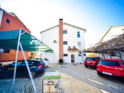 Photo for Holiday apartment with 4 bathrooms only 250 meters from the Adriatic Sea
