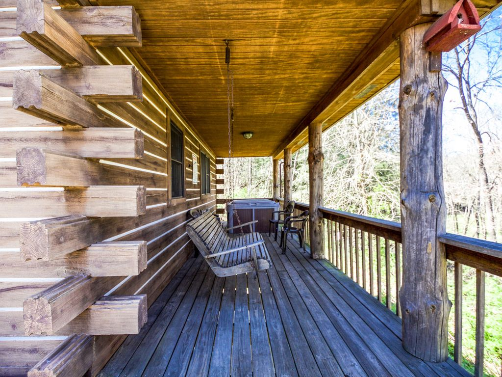 hocking cabin deck and mans your getaway old images lodge new hottub pet fire cave dog liberty pit cabins near ridge of hills in fresh turkey friendly