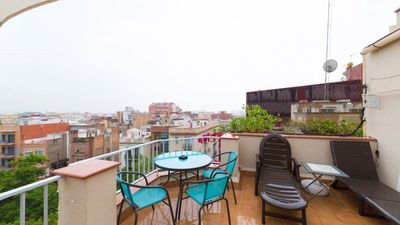 Photo for Orange Duplex with sunny terrace in Barcelona