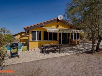 Photo for Romantic holiday house with pool, surrounded by olive trees, in beautiful nature