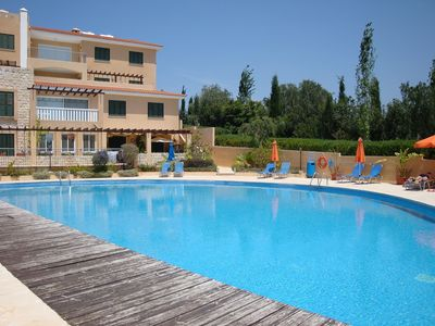 Large communal pool with sun beds and parasols provided provided