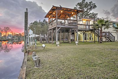 This expansive deck overlooks the river and provides views of glowing sunsets.