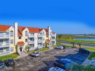 Photo for Condo w/ waterfront views & shared pool/hot tub/gym - steps to beach, 2 dogs OK!