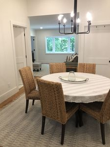 The dining area opens to the living room. The sunroom is to the right.