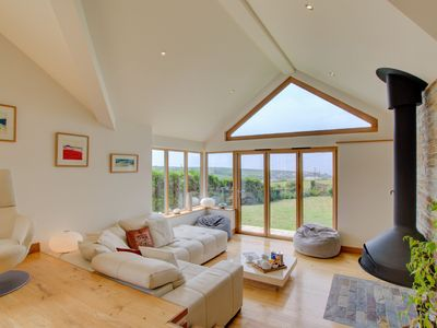 Photo for Light and modern detached holiday home with private garden near the beach
