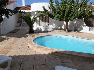 Photo for <![CDATA[CASA CARPA A, Ideal house for your holidays near the sea, free wifi, air conditioning, community pool, pets allowed, dog's beach.]]>