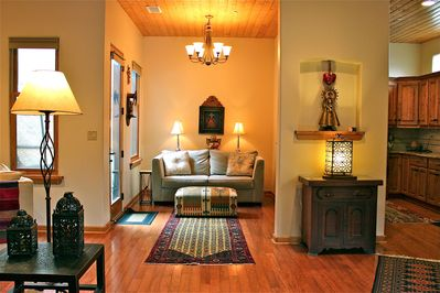 3 Sofa Living area. Oriental rugs, hardwood floors & wood ceiling.
