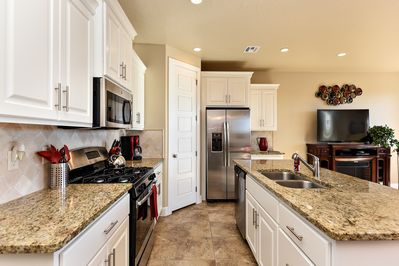 Kitchen - The Kitchen is complete with everything you will need for meal preparations including pots, pans, baking dishes, plates, cups, silverware, cutlery, and an assortment of cooking utensils