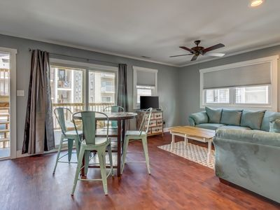Photo for Bright, modern condo just moments from soft sandy beach!