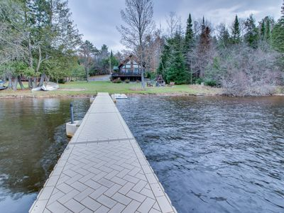 Photo for NEW LISTING! Lakefront lodge w/private dock, firepit, deck & sunset views