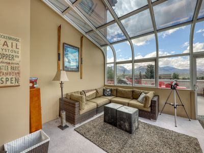 Photo for Mountain views from the balcony - laundry, fireplace & parking included!