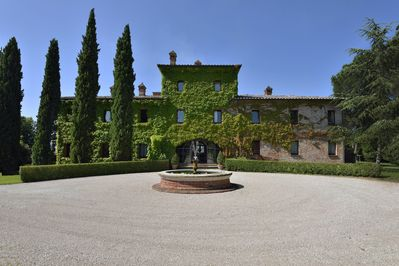 North face of the Villa with fountain and parking area.