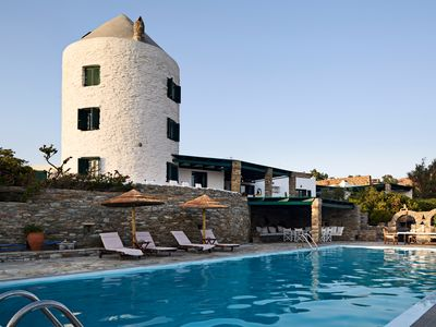 Photo for Windmill Retreat - Swimming Pool and Sea Views close to a Pebble Cove