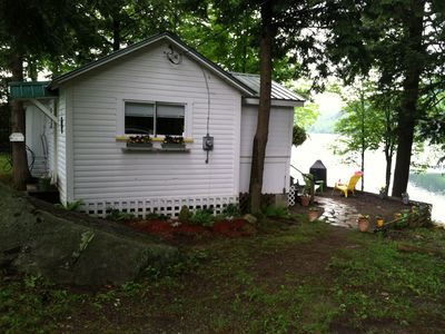 Photo for Charming lake cottage steps from water! Beautiful location & cute as a button!
