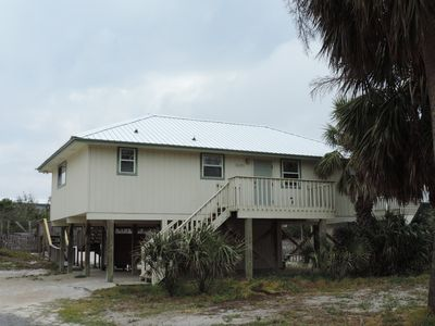 Photo for SALTY PAWS - Adorable dog friendly gulf side getaway, short walk to the beach.