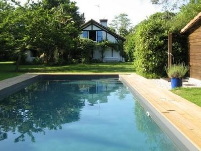 Photo for Traditional Landes house with pool, close to the ocean.