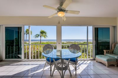 View of Gulf of Mexico from living room and lanai with pocket doors opened.