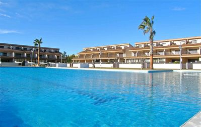 Photo for Beside the beach, tennis, pools & only 900m from the village.