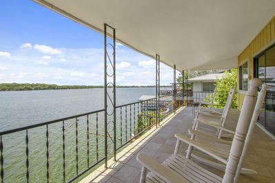 Upper covered deck with spectacular sunset views to the right and seating