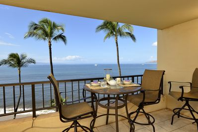 lanai with views of Maalaea Bay. with bar stool height chairs  see over railing