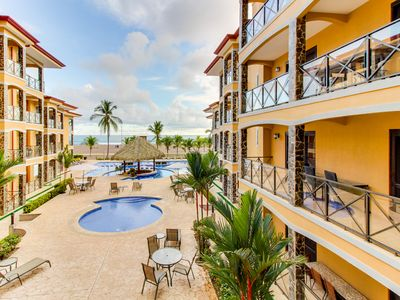 Photo for Elegant condo in beachfront property with shared pool and ocean views!