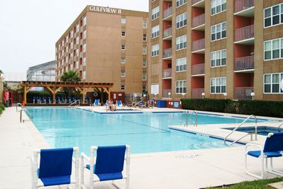 Very large pool with hot tub and kiddy pool.