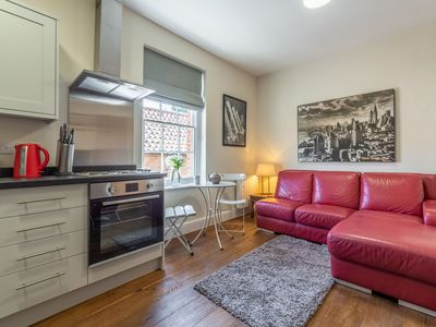 Photo for A cool first floor apartment which sleeps two and has a gorgeous garden to enjoy