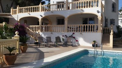 Photo for Walking distance to town & beach.heated pool,air conditioging,wifi,table tennis