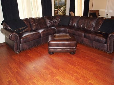 COMFORTABLE LEATHER SECTIONAL AND THROW BLANKETS FOR YOUR COMFORT