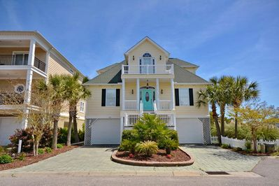 This luxurious home is on a corner channel lot only a few blocks from the beach.